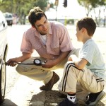 dad and son watching tire
